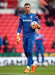 Stoke City goalkeeper Jack Butland warms up before the Premier League match at the bet365 Stadium, Stoke