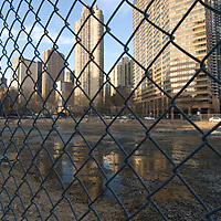 A fence surounds a vacant lot in east cental Manhattan, New York City.
