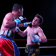 Samuel Figueroa of Puerto Rico punches Ismat Eynullayev of Azerbijan during the Puerto Rico vs The World boxing event at Orlando Live Events Center on Friday, March 24, 2017 in Casselberry, Florida.  (Alex Menendez via AP)