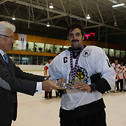Mitchell Frear, New Zealand, receives the third place plate award for the tournament from Kai Hietariinta, IIHF Tournament Chairman at the conclusion of the 2012 IIHF Ice Hockey World Championships Division 3 held at Dunedin Ice Stadium. Dunedin, Otago, New Zealand. 22nd January 2012. Photo Tim Clayton