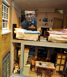 © Licensed to London News Pictures. 04/04/2012. London, UK 93 year old Harry Allpress looks at a detailed model of his house. The intricate model of the family home in South London during wartime was made by a family friend and features in the exhibition. Photo call and preview for the Imperial War Museums new A Family in Wartime exhibition. The exhibition features the life on the Home Front during the Second World War, explored through the eyes of one London based family, the Allpress. Photo credit : Stephen SImpson/LNP