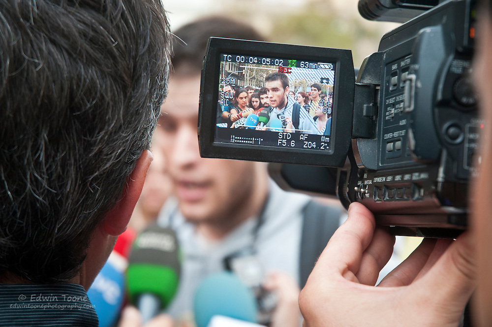 A student representative answers questions from the media about the student protest.