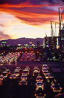 Traffic on Tropicana Avenue, looking west, at sunset (Crossing Las Vegas Boulevard, The Strip), Las Vegas, Nevada USA