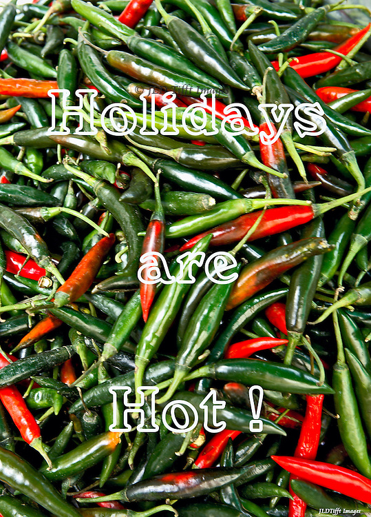 Long red and green hot chili peppers in an edge-to-edge pattern with the text superimposed in white.