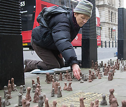 Westminster, February 8th 2017. Protesters from the London Mining Network and Coal Action Network create an installation outside the Department for Business, Energy and Industrial Strategy, of 2,900 figurines representing the lives of those who die every year thanks to coal related illness. The protest comes as the government, which still subsidises coal-fired power stations ends its public consultation whether to phase out coal in 2025.