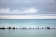 Breaking storm brings a sudden calm on the coast at Port Fairy along the Great Ocean Road in Australia in the State of Victoria. Licensing and Editions of 17