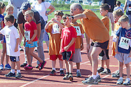 Central Valley, New York - Young runners get ready to race on the track in the Coach/Judge Ed Kellmen Ramble Scramble on Aug. 26, 2012.