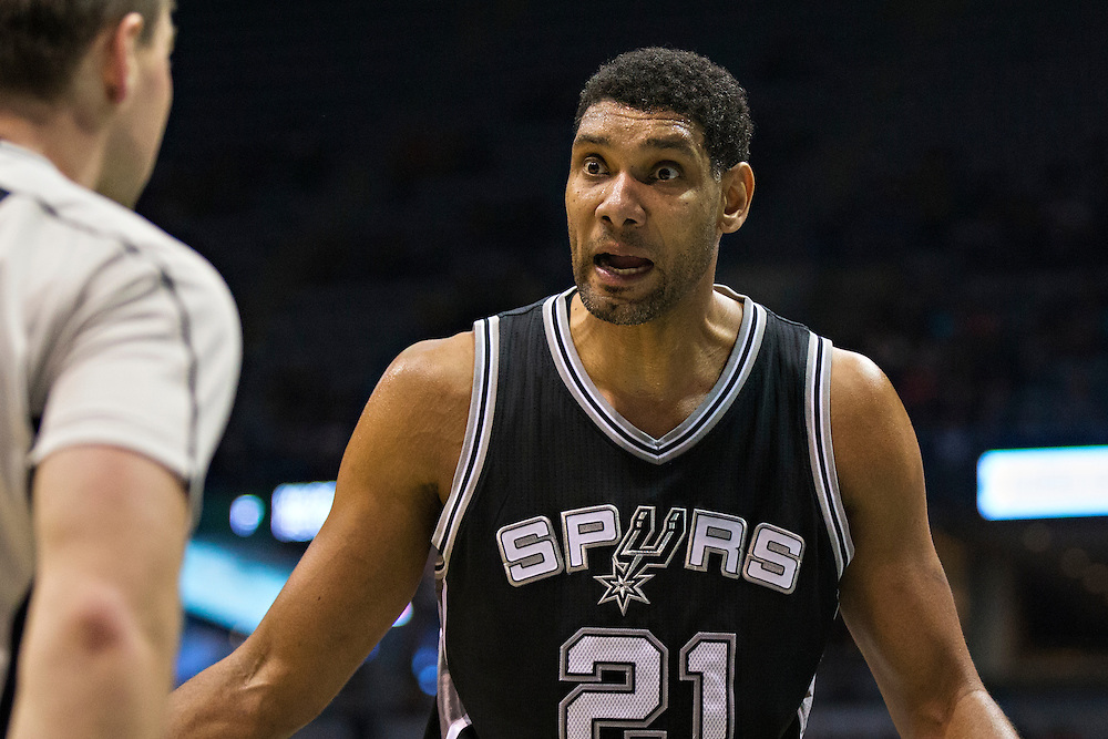 """MILWAUKEE, WI- JANUARY 4:  Tim Duncan #21 of the San Antonio Spurs questions a foul call during a game against the Milwaukee Bucks at BMO Harris Bradley Center on January 4, 2016 in Milwaukee, Wisconsin.  """"NOTE TO USER: User expressly acknowledges and agrees that, by downloading and or using this photograph, User is consenting to the terms and conditions of the Getty Images License Agreement.""""(Photo by Wesley Hitt/Getty Images) *** Local Caption *** Tim Duncan"""