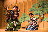 """Kyogen Theatre, literally """"mad words"""" or """"wild speech"""" is a form of traditional Japanese theater. It developed alongside noh, was performed along with noh as an intermission of sorts between noh acts, and retains close links to noh to this day.  However, its content is not at all similar to the formal, symbolic, and solemn noh theater.  Kyogen is a comical form, and its primary goal is to make its audience laugh."""