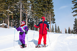 California: Northstar at Lake Tahoe, couple snowshoeing.    Photo copyright Lee Foster.  Photo # cataho100346
