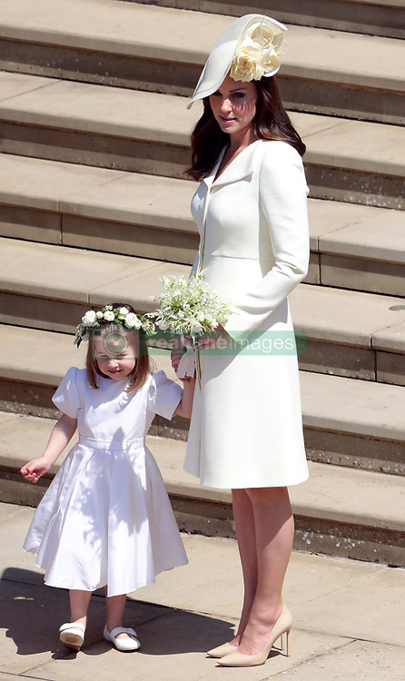 Duchess of Cambridge and Princess Charlotte after the wedding of Prince Harry and Meghan Markle at Windsor Castle.