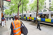 """London, United Kingdom, May 28, 2021: A legal observer is seen at the scene as people holding banner, placards and waving Palestinian flags are shouting """"Shut Elbit Down"""" outside the HQ Office of Elbit Systems in central London on Friday, May 28, 2021. (Photo by Vudi Xhymshiti)"""