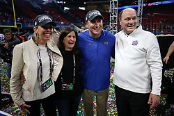 Florida Gators head coach Dan Mullen celebrates winning the Chick-fil-A Peach Bowl with his wife Megan, Chick-fil-A Peach Bowl President and CEO Gary Stokan and his wife Tia Saturday, December 29, 2018, in Atlanta. (Jason Parkhurst via Abell Images for Chick-fil-A Peach Bowl)