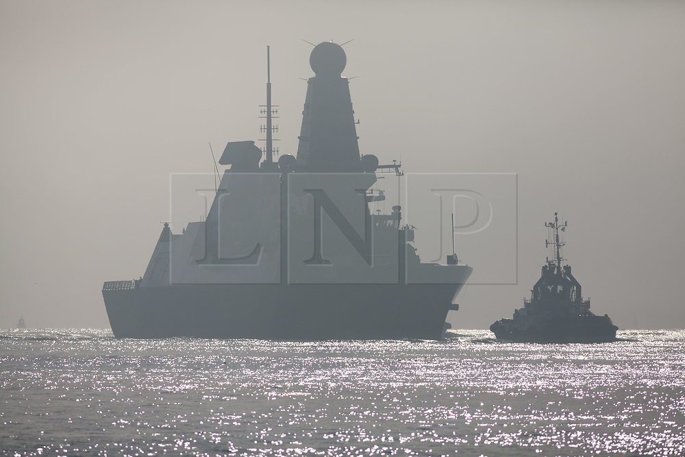 © Licensed to London News Pictures. 02/11/2017. Portsmouth, UK.  HMS Dragon sails through the mist into her home port of Portsmouth for the first time in two months.  The Type 45 destroyer has been on a deployment involving exercises with the U.S. Navy and also a visit to the British Overseas Territory of Gibraltar.  Photo credit: Rob Arnold/LNP