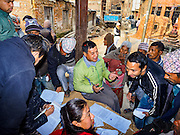 01 MARCH 2017 - KHOKANA, NEPAL: Nepal government officials meet with residents in Khokana to help them apply for financial assistance for rebuilding homes destroyed in the 2015 earthquake. Recovery seems to have barely begun nearly two years after the earthquake of 25 April 2015 that devastated Nepal. In some villages in the Kathmandu valley workers are working by hand to remove ruble and dig out destroyed buildings. About 9,000 people were killed and another 22,000 injured by the earthquake. The epicenter of the earthquake was east of the Gorka district.     PHOTO BY JACK KURTZ