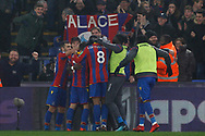 Wilfried Zaha of Crystal Palace (hidden) celebrates with his team mates and subs after he scores his team's second goal. Premier League match, Crystal Palace v Everton at Selhurst Park in London on Saturday 18th November 2017.<br /> pic by Steffan Bowen, Andrew Orchard sports photography.