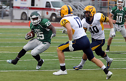 18 October 2014:  Anfernee Roberts pursued by Erik Johnson and Ben Fornek during an NCAA division 3 football game between the Augustana Vikings and the Illinois Wesleyan Titans in Tucci Stadium on Wilder Field, Bloomington IL