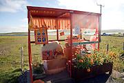 Orange colour theme decorated bus shelter, Haroldswick, Unst, Shetland Islands, Scotland