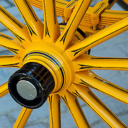 Yellow spokes of horse carriage wheel, Seville, Spain (January 2007)