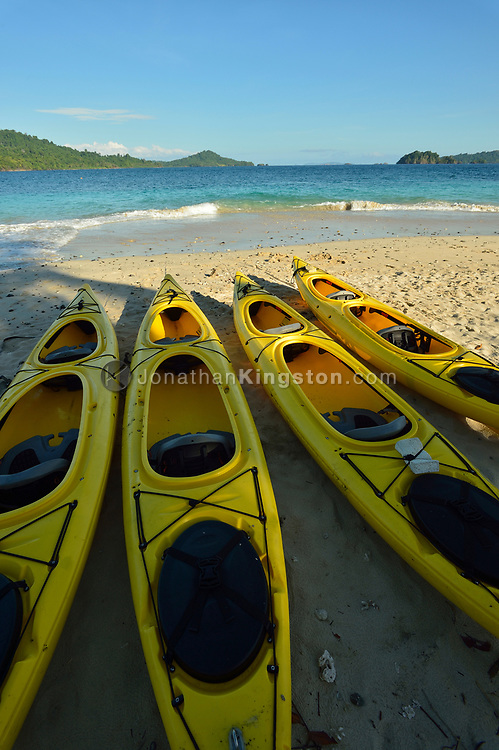 Yellow kayaks lined up on the beach of Granito De Oro Island (Little Grain of Gold Island), one of the most pristine beaches in the world, Coiba National Park (Parque Nacional Coiba), gulf of Chiriqui, Panama.