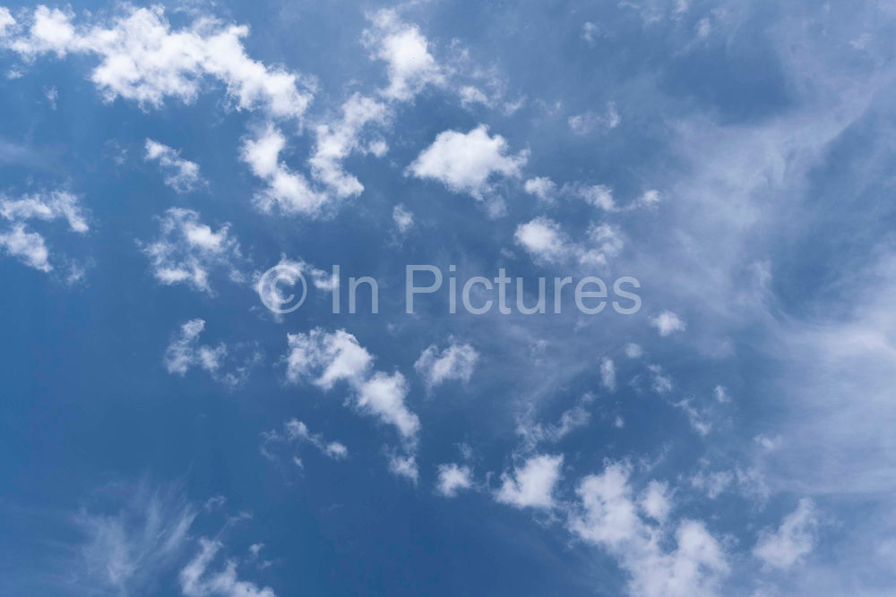 Blue skies and high-altitude cirrus clouds above south London, on 2nd June 2021, in London, England.