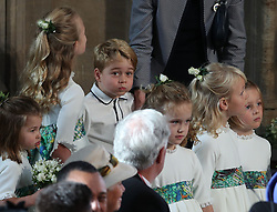 The bridesmaids and page boys, including Prince George and Princess Charlotte, arrive for the wedding of Princess Eugenie to Jack Brooksbank at St George's Chapel in Windsor Castle.