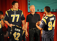 7 APRIL 2013 -- ST. LOUIS -- President Bill Clinton greets St. Louis Rams football players Chris Givens (13), Jake Long (77) and Robert Quinn (94) during the Clinton Global Institute University Service Project at Gateway STEM High School  in St. Louis Sunday, April 7, 2013. Photo by Sid Hastings, © copyright 2013 Washington University in St. Louis.