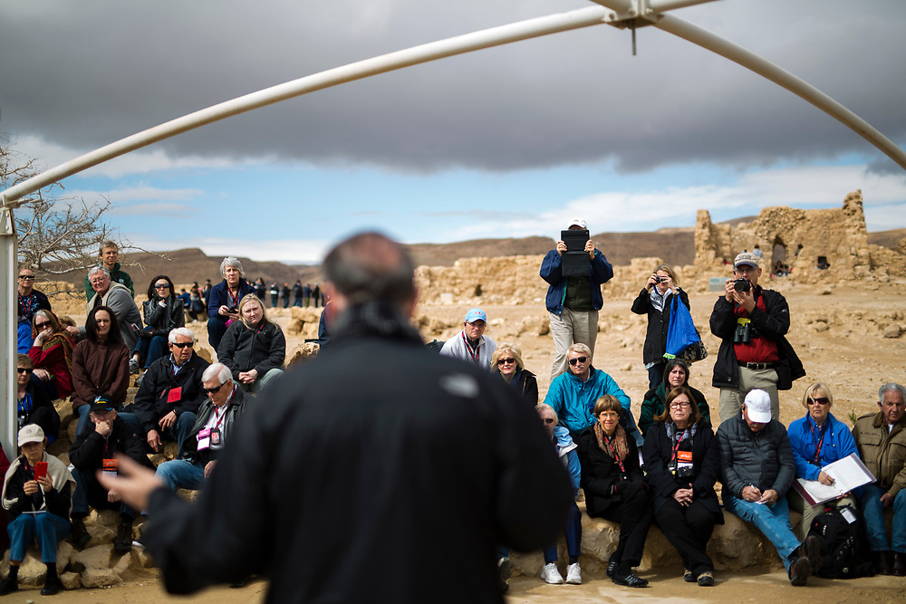 Former Arkansas governor Mike Huckabee, is seen from the back as he delivers a speech to a group of American Evangelical Christian tourists and pilgrims led by him, during a visit to the ancient hilltop fortress of Masada in the Judean desert in Israel, on February 19, 2015. The ancient ruined desert fortress on a wind-swept plateau overlooking the Dead Sea is seen by many as an emblem of Israel's fighting spirit, it is believed to be the place where close to a thousand Jewish rebels killed themselves and each other about two millennia ago, rather than surrender and fall into slavery under the Romans.