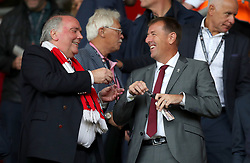 """Former Southampton player Matt Le Tissier (right) in the stands before the Premier League match at St Mary's, Southampton. PRESS ASSOCIATION Photo. Picture date: Sunday August 12, 2018. See PA story SOCCER Southampton. Photo credit should read: Andrew Matthews/PA Wire. RESTRICTIONS: EDITORIAL USE ONLY No use with unauthorised audio, video, data, fixture lists, club/league logos or """"live"""" services. Online in-match use limited to 120 images, no video emulation. No use in betting, games or single club/league/player publications."""