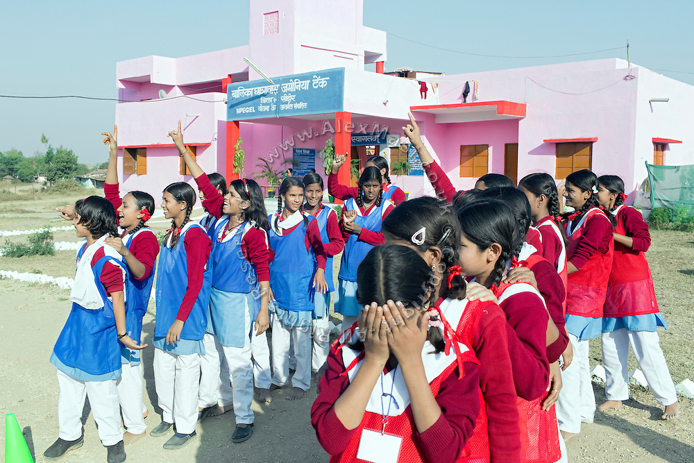 Ritu Gaur, 13, (fourth in the left line) is celebrating her team's victory in the game of Hurdle Race in front of the Jamoniya Tank Girls Hostel, near Sehore, Madhya Pradesh, India, where the Unicef India Sport For Development Project has started in 2012. Covering 313 state-run girls' hostels and 207 mixed hostels in Madhya Pradesh, the project ensures that children from Scheduled Tribes (ST) and others amongst the poorest people in India, can easily access education and be introduced to sports. Field workers from Unicef also oversee their nutrition and monitor the overall conditions of each pupil.