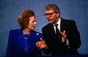 Ex-British Prime Minister Margaret Thatcher with current premier John Major at 1991 Tory party conference. A year after her colleagues deposed her, forcing her to resign from her 11 year premiership, she talks after her speech to the present Prime Minsiter from the stage. Thatcher has been lending her support to her replacement, the former Chancellor and Foreign Secretary, but the otherwise unknown John Major who governed until 1997.