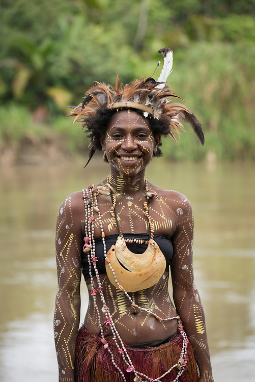 A young woman wearing a feather hat during a celebration at Yar village, locaed on the Keram River in the East Sepik Province of Papua New Guinea. The community was celebrating the dedication of the New Testament into the Waran language, one of hundreds of languages in the country. (June 22, 2019)