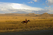 A young man rides horseback just outside of Teyateyaneng, Lesotho. For many in Lesotho, ranked by the United Nations as one of the poorest countries in the world, there is no escaping the poverty.