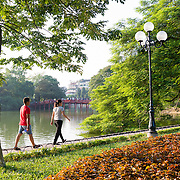 People strolling around Hoan Kiem Lake in late afternoon, Hanoi.