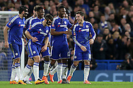 Eden Hazard of Chelsea (r) celebrates after scoring his sides 4th goal with Mikel John Obi of Chelsea and the rest of the team to make it 4-1. The Emirates FA Cup, 5th round match, Chelsea v Manchester city at Stamford Bridge in London on Sunday 21st Feb 2016.<br /> pic by John Patrick Fletcher, Andrew Orchard sports photography.