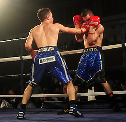Lee Haskins lands a heavy blow on Martin Ward in the final moments of the fight - Photo mandatory by-line: Dougie Allward/JMP - Tel: Mobile: 07966 386802 27/04/2013 - SPORT - FOOTBALL - City Academy Sports Centre - Bristol - Lee Haskins V Martin Ward - British bantamweight title