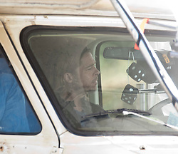 """Brad Pitt filming in a camper van, on the set of the movie """"World War Z"""" being shot today in Grangemouth, Scotland. The film, which is set in Philadelphia, is being shot in various parts of the Glasgow, transforming it to shoot the post apocalyptic zombie film.."""