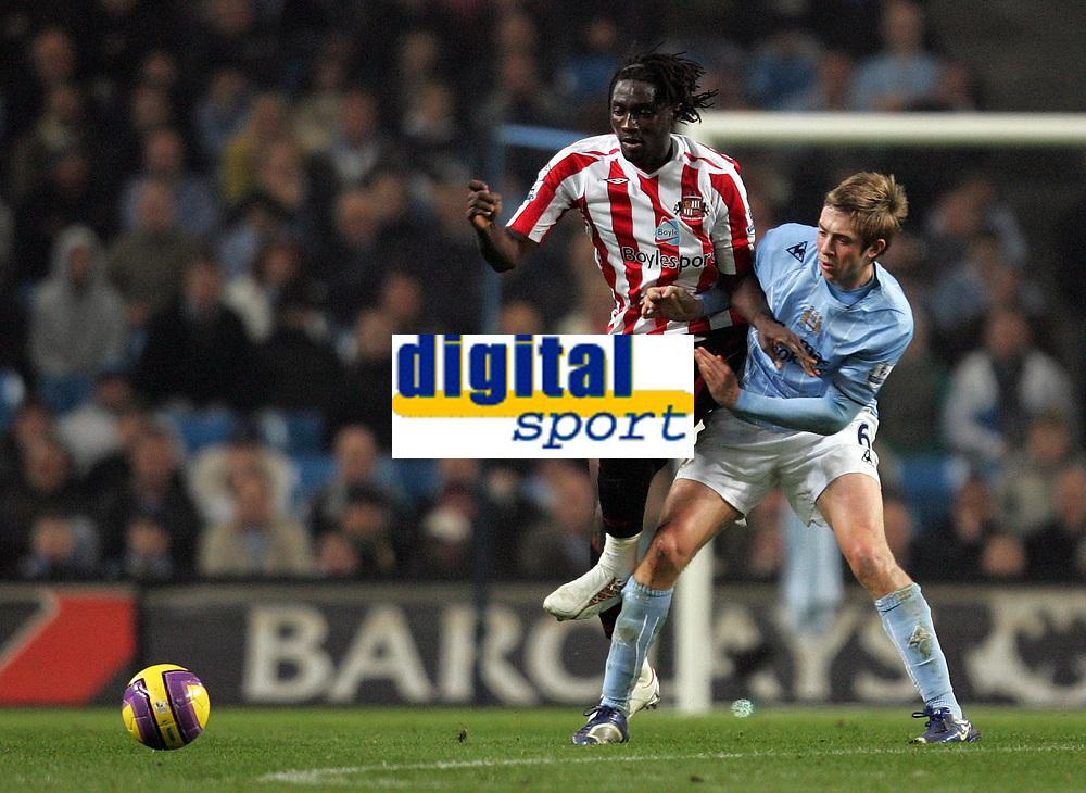 Photo: Paul Thomas/Sportsbeat Images.<br /> Manchester City v Sunderland. The FA Barclays Premiership. 05/11/2007.<br /> <br /> Sunderland's Kenwyne Jones (L) is tackled by Michael Johnson.