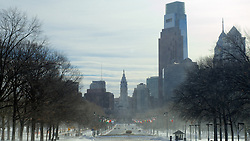 City Hall and Philly's skyline form the backdrop of this snowy scene on the Benjamin Franklin Parkway.