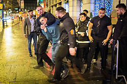 © Licensed to London News Pictures . 01/01/2015 . Manchester , UK . A man is ejected from Tiger Tiger . Revellers usher in the New Year on a night out in Manchester City Centre .  Photo credit : Joel Goodman/LNP