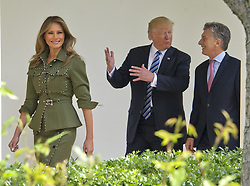 April 27, 2017 - Washington, District of Columbia, United States of America - United States President DONALD J. TRUMP shares a conversation with President MAURICIO MACRI of Argentina as first lady MELANIA TRUMP leads the way on the Colonnade of the White House. (Credit Image: © Ron Sachs/CNP via ZUMA Wire)
