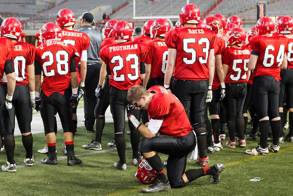 Boone Central senior Hunter Henry takes a knee behind his team in the final moments of the fourth quarter of their Class C-1 state championship game against Norfolk Catholic Tuesday at Memorial Stadium in Lincoln. Norfolk Catholic won 24-13. (Independent/Matt Dixon)