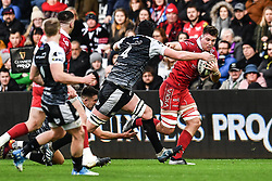 Ed Kennedy of Scarlets in action during todays match<br /> <br /> Photographer Craig Thomas/Replay Images<br /> <br /> Guinness PRO14 Round 11 - Ospreys v Scarlets - Saturday 22nd December 2018 - Liberty Stadium - Swansea<br /> <br /> World Copyright © Replay Images . All rights reserved. info@replayimages.co.uk - http://replayimages.co.uk