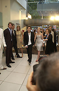 """Scarlett Johansen and Ewan McGregor at the UK Premiere of """"The Island"""" at the Odeon Leicester Square, London. 7 August 2005. , ONE TIME USE ONLY - DO NOT ARCHIVE  © Copyright Photograph by Dafydd Jones 66 Stockwell Park Rd. London SW9 0DA Tel 020 7733 0108 www.dafjones.com"""