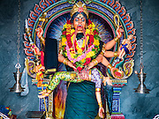 "27 DECEMBER 2015 - SINGAPORE, SINGAPORE: A depiction of the Goddess Kali in Sri Veeramakaliamman Temple in Singapore. Sri Veeramakaliamman Temple in the ""Little India"" section of Singapore, was one of the first Hindu temples in Singapore and is dedicated to the Goddess Kali, the Hindu ""Destroyer of Evil.""  It's on Serangoon Road, which at one time was the center of Singapore's Indian community and served Indian immigrants who worked in the cattle trade that was based around Serangoon Road in the 19th century. Now the temple is a popular tourist site.     PHOTO BY JACK KURTZ"