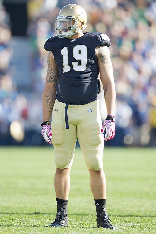Notre Dame defensive end Aaron Lynch (#19) in action during NCAA football game between Notre Dame and Air Force.  The Notre Dame Fighting Irish defeated the Air Force Falcons 59-33 in game at Notre Dame Stadium in South Bend, Indiana.