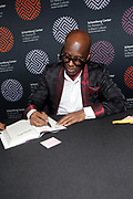 HARLEM, NEW YORK-DECEMBER 9: Designer/Fashion Icon Daniel 'Dapper Dan' Day attends and signs books at the Heritage Series held at the Schomburg Center, a part of the New York Public Library on December 9, 2019 in Harlem, New York City.   (Photo by Terrence Jennings/terrencejennings.com)
