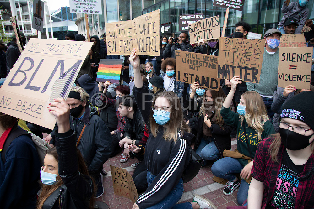 Following the death of George Floyd while in the custody of police in Minneapolis, demonstrations of solidarity have started all over the world as people gather to protest against institutional racism and in support of the Black Lives Matter movement, as seen here with thousands of people, mostly wearing face masks, taking the knee in Centenary Square on 4th June 2020 in Birmingham, England, United Kingdom. Black Lives Matter is an international human rights movement, originating in the African-American community, that campaigns against violence and systemic racism towards black people.