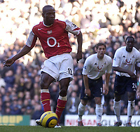 Fotball<br /> England 2004/2005<br /> Foto: SBI/Digitalsport<br /> NORWAY ONLY<br /> <br /> Tottenham Hotspur v Arsenal<br /> 13/11/2004<br /> <br /> Arsenal's Lauren scores the third goal from the penalty spot
