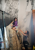 Gwen Ripps, 6, tops out while learing the ropes of climbing Saturday from Grand Teton National Park Chief of Interpretation Vickie Mates during Junior Ranger Day in Moose.